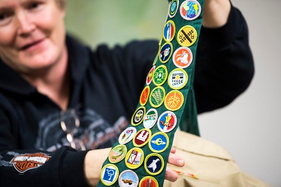 (Chris Detrick | The Salt Lake Tribune) Diane Blythe shows the Boy Scout merit badges her son Logan earned.