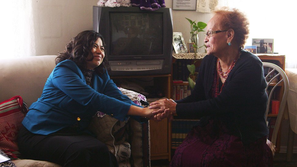 (Courtesy photo | The Church of Jesus Christ of Latter-day Saints) Reyna I. Aburto of the Relief Society general presidency holds the hands of Elsie Gray of the Fort Wingate Branch during a visit to her home near Gallup, N.M, Thursday, Nov. 8, 2018.