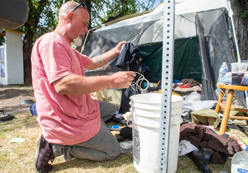 (Rick Egan | The Salt Lake Tribune) Richard Ryan prepares to move his camp on Wednesday, Sept. 9, 2020, after getting notified that first thing in the morning he will be forced to move from Taufer Park in Salt Lake City, fearing everything will be taken from him if he is not prepared when they arrive.