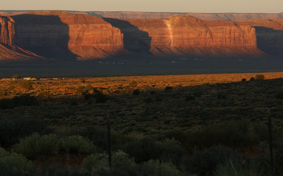(Leah Hogsten | Tribune file photo) In this 2010 photo, a white line along the face of the Oljato Mesa in Monument Valley marks the Skyline uranium mine and its rubble piles that contaminate the land with radiation, just a few hundred feet from where Navajo residents have lived since the 1950s.