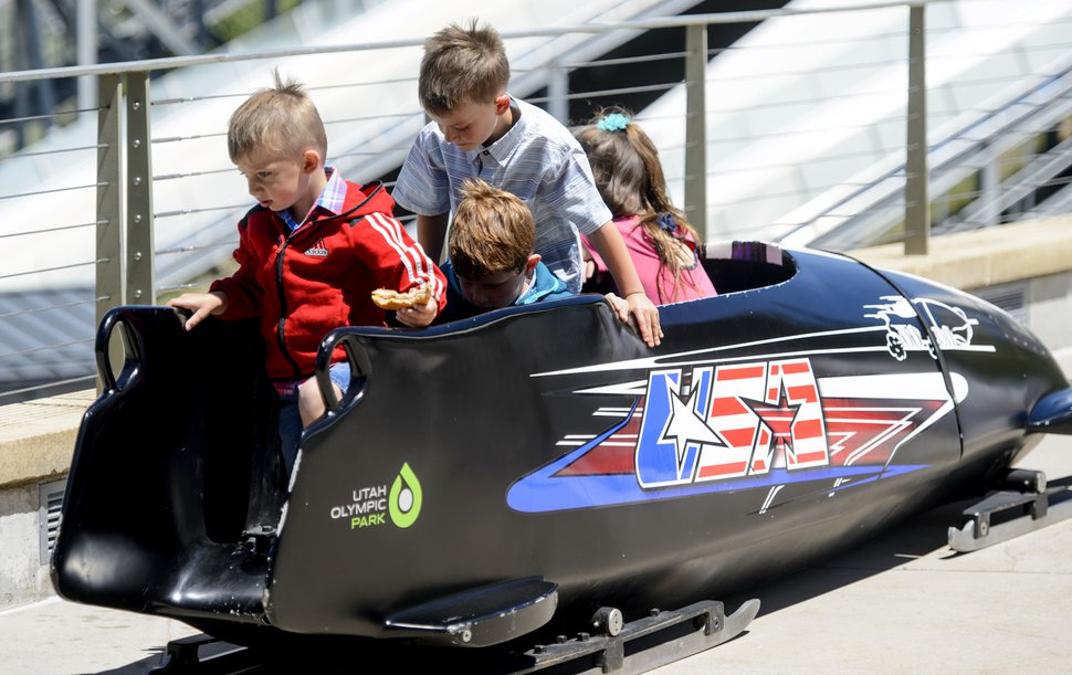 Steve Griffin | The Salt Lake Tribune Children play in a bobsled as Park City and the Holcomb family and friends hold a memorial to honor Steve Holcomb the late 37-year-old Park City gold medalist bobsledder who passed away suddenly in Lake Placid last month. The remembrance was held in the summer pavilion at Utah Olympic Park Park City Saturday June 10, 2017.