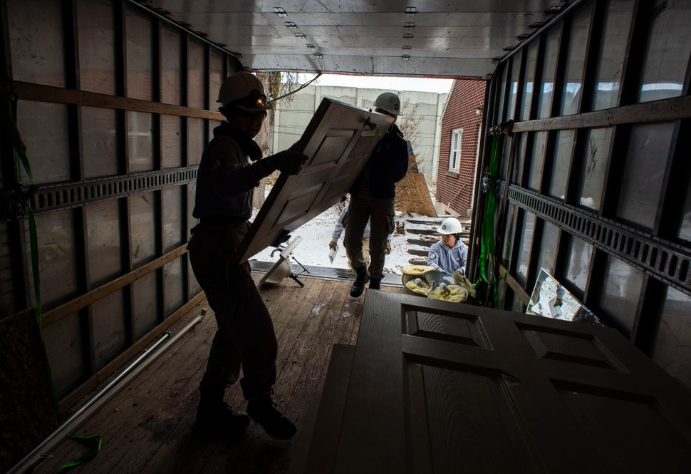 (Rick Egan | The Salt Lake Tribune) Tierra Pouttu-Clarke and Taylor Drake from AmeriCorps, removes a closet door from a home that will be demolished for freeway widening, for UDOT and Habitat for Humanity, Wednesday, Jan. 16, 2019.