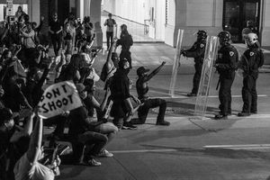 (Trent Nelson  |  The Salt Lake Tribune) Protesters stand off with police while marching through Salt Lake City on Monday, June 1, 2020.