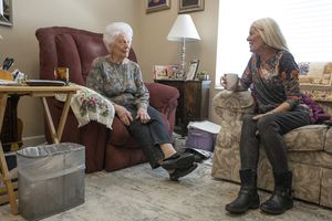 (Leah Hogsten | The Salt Lake Tribune)  Barbara Harding shares a laugh with her mother Jeanette Wilkins, 88, during a visit at The Ridge Cottonwood, a long-term care facility where Wilkins lives, Mar. 24, 2021. Wilkins gets visits from her family members in her room now that the facility is starting to loosen its visitor restrictions.