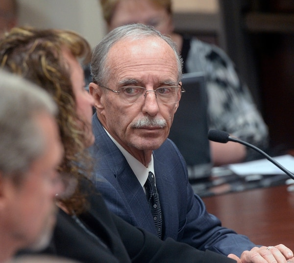 (Al Hartmann | Tribune file photo) In this Oct. 4, 2016, photo, Salt Lake County County Recorder Gary Ott sits with his chief deputy, Julie Dole, before the Salt Lake County Council's presentation of findings of the county auditor's performance review in Salt Lake City.