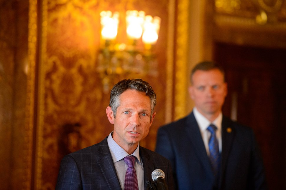 (Trent Nelson | The Salt Lake Tribune) Derek Miller speaks after Governor Gary Herbert condemned the actions of protesters who occupied the Chamber of Commerce Building Tuesday. Herbert spoke at a news conference in Salt Lake City on Wednesday July 10, 2019. At right is Commissioner Jess Anderson.