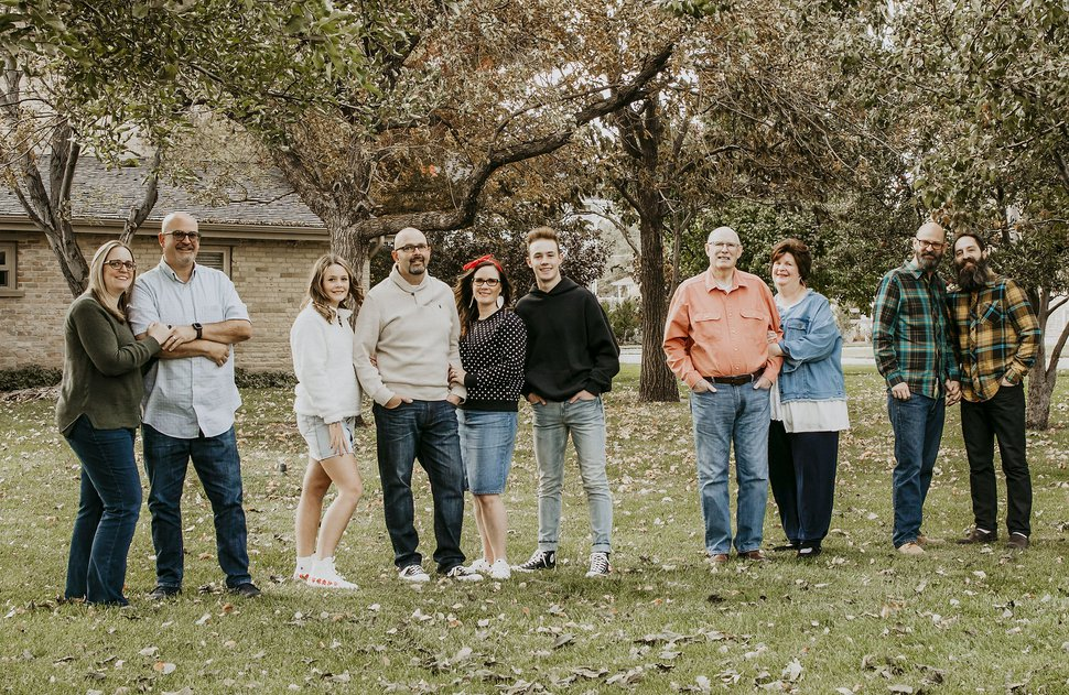 (Photo courtesy of the Moody family) The Moody family, left to right, Laura and Rick Moody; Olivia, Roger, Hilary, Zander Moody; parents John, Carol Ann Moody and Robert Moody and spouse Glen Hoen. Six people in the Moody family contracted COVID-19. Robert, Glen, Robert's father John, mother Carol Ann and brother Roger and sister-in-law Hilary Moody all had the virus. Carol Ann Moody died from COVID-19.