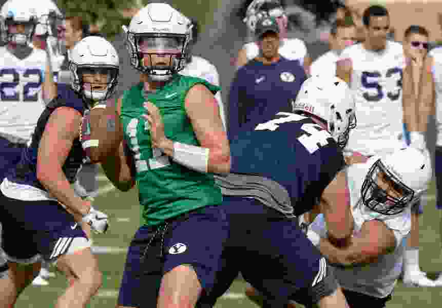 BYU coaches are hoping that Saturday's closed scrimmage will clear up their starting quarterback battle, but at least one says they might keep it a mystery until kickoff