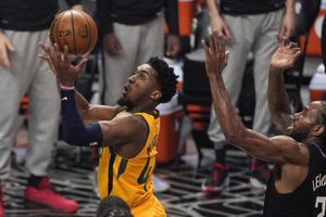 Utah Jazz guard Donovan Mitchell, left, shoots as Los Angeles Clippers forward Kawhi Leonard defends during the first half in Game 4 of a second-round NBA basketball playoff series Monday, June 14, 2021, in Los Angeles. (AP Photo/Mark J. Terrill)