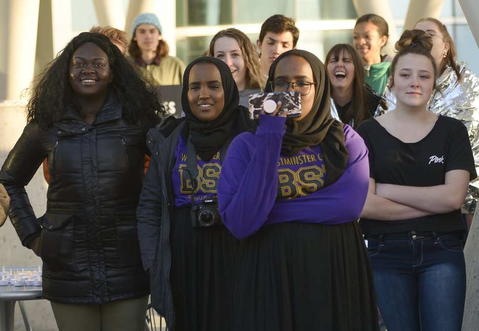 (Leah Hogsten | The Salt Lake Tribune) Participants laugh along with speaker Ashley Finley Ashley Finley who talks about her experience with a West Valley Police officer in January 2017 at a Black Lives Matter vigil and rally Friday, April 13, 2018 at the Salt Lake City Police Department.
