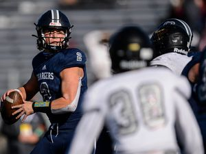 (Trent Nelson  |  The Salt Lake Tribune) Corner Canyon's Jaxson Dart during the 6A state football championship game against Lone Peak at Cedar Valley High School in Eagle Mountain on Friday, Nov. 20, 2020.
