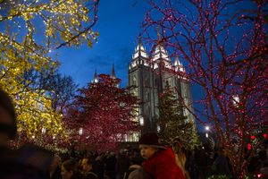(Chris Detrick  |  Tribune file photo) Visitors look at Christmas Lights on Temple Square on Nov. 24, 2017.