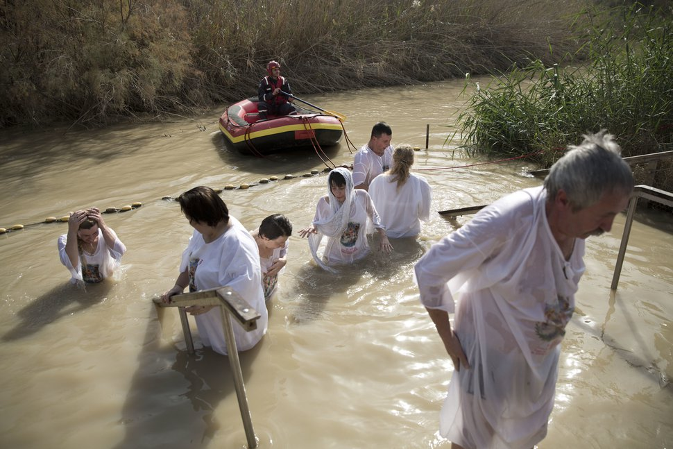 (Oded Balilty | The Associated Press) In this Wednesday, Jan. 18, 2017, photo, Christian Orthodox pilgrims immerse themselves in the waters of the River Jordan during a baptism ceremony as part of the Orthodox Feast of the Epiphany at Qasr el Yahud, the spot where John the Baptist is said to have baptized Jesus, near the West Bank town of Jericho.