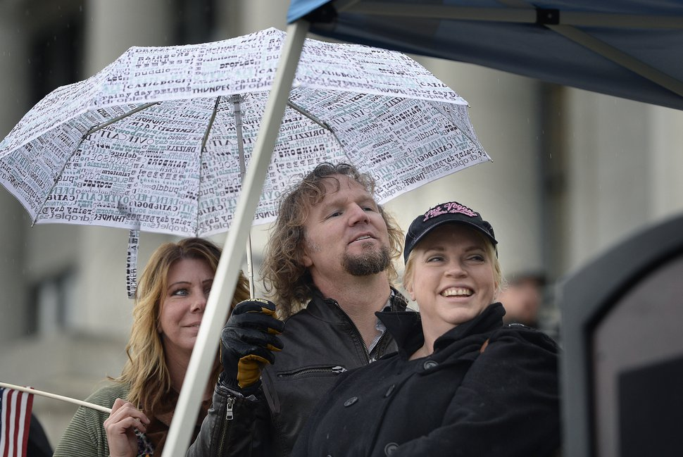 (Scott Sommerdorf | Tribune file photo) Polygamist Kody Brown listens to his wife Christine speak to polygamists and their supporters at a rally on the south steps of the Capitol, Friday, Feb. 10, 2017.