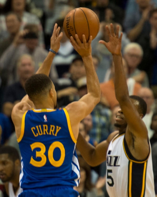 Rick Egan | The Salt Lake Tribune Golden State Warriors guard Stephen Curry (30) shoots a 3-point shot over Utah Jazz guard Rodney Hood (5), giving the Warriors a 104-101 lead with 49 seconds left in the game, in NBA action the Utah Jazz vs. the Golden State Warriors, in Salt Lake City, Monday, November 30, 2015.