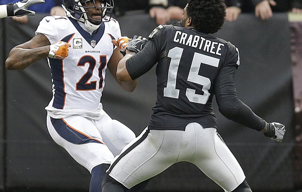 Raiders beat Broncos 21-14 in fight-filled game