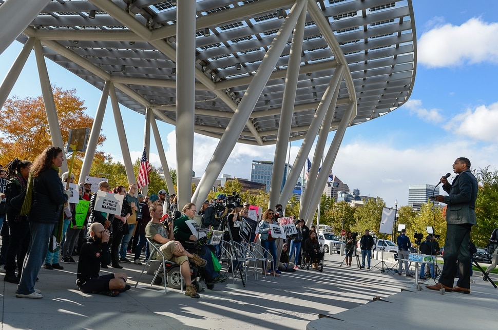 (Francisco Kjolseth   The Salt Lake Tribune) People gather to demand justice for the killing of Patrick Harmon who was shot by police on Aug. 13, when he tried to flee after being stopped on his bicycle. Around 150 people gathered for the rally at the Salt Lake City Public Safety Building on Sunday, Oct. 8, 2017, demanding Salt Lake County district attorney Sim Gill be fired for his