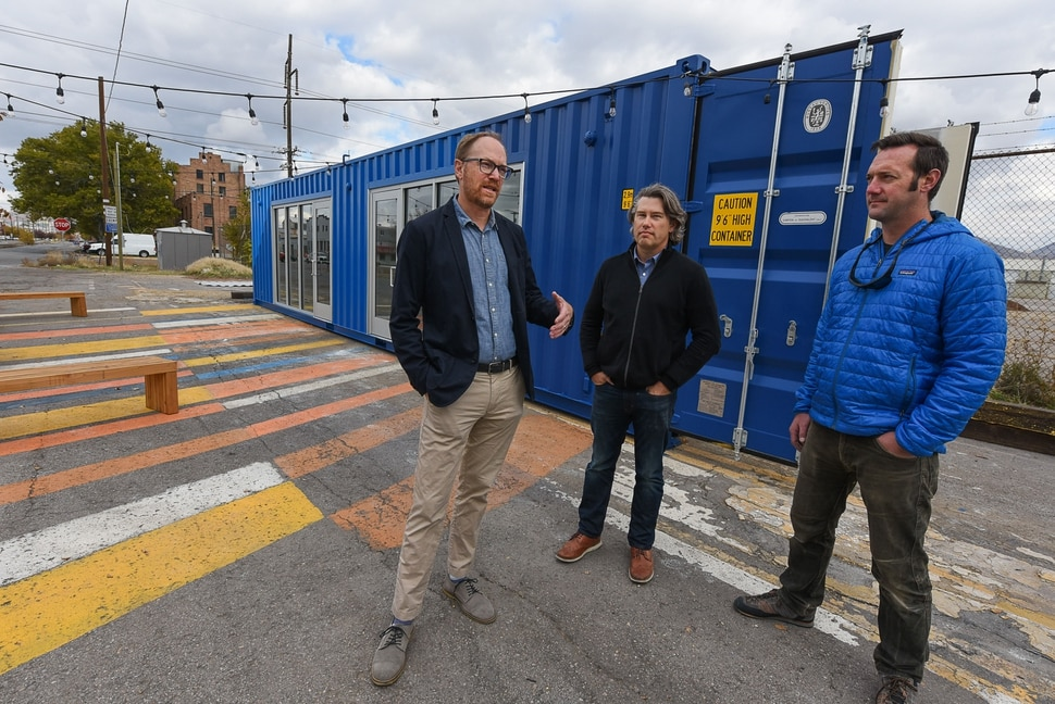 (Francisco Kjolseth | The Salt Lake Tribune) Michael Yount, left, and Tim Sullivan, founders of a small Salt Lake City company called Little City, along with contractor James Emery, are offering shipping containers as repurposed spaces for doing business. The two founders set up a pop-up project demonstrating the idea called FLEET, near the northwest corner of Fleet Block, an RDA-owned parcel bounded by 800 and 900 South and 300 and 400 West.