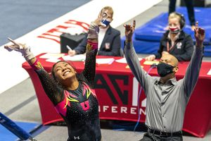 (Rick Egan | The Salt Lake Tribune) Cristal Isa and coach Tom Farden react after Isa lands her dismount from the uneven bars, in PAC-12 gymnastics action Utah vs Arizona, at the Huntsman Center onSaturday, Jan. 23, 2021.