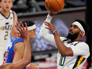 Utah Jazz guard Mike Conley (10) shoots as Detroit Pistons center Jahlil Okafor, left, defends during the first half of an NBA basketball game, Sunday, Jan. 10, 2021, in Detroit. (AP Photo/Carlos Osorio)