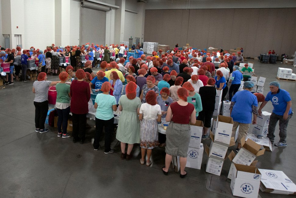 (Photo courtesy of The Church of Jesus Christ of Latter-day Saints) Volunteers assemble meals for children Aug. 26, 2019. The project, which is taking place this week in the Salt Palace, is part of the 68th United Nations Civil Society Conference.