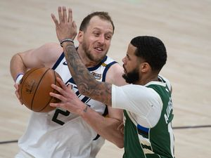 (Francisco Kjolseth  | The Salt Lake Tribune) Utah Jazz forward Joe Ingles (2) is pressured by Milwaukee Bucks guard D.J. Augustin (12) as the Utah Jazz take on the Milwaukee Bucks at Vivint Smart Home Arena in Salt Lake City, on Friday, Feb. 12, 2021.