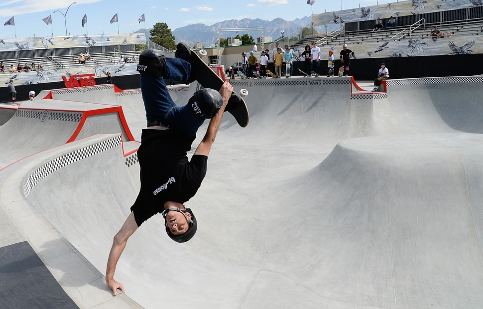 (Francisco Kjolseth | The Salt Lake Tribune) Skate legend Tony Hawk delights the crowd with an invert as he joins other pro skaters for a community skate during a first look of the new Vans - Utah Sports Commission Skatepark at the Utah State Fairpark on Tuesday, Sept. 3, 2019.