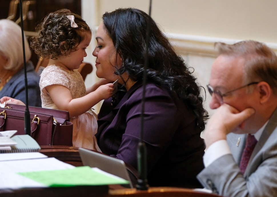 (Francisco Kjolseth | The Salt Lake Tribune) Senator Luz Escamilla is joined by her daughter Sofia, 21-months, on the senate floor for the opening of the 2018 legislative session at the Utah Capitol on Monday, Jan. 22, 2018.