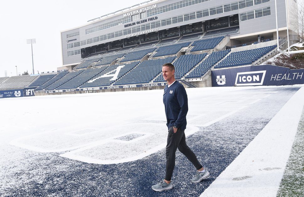 (Francisco Kjolseth | The Salt Lake Tribune) USU football coach Gary Andersen recalls a lot of memories as he walks on Merlin Olsen Field with a fresh coat of snow after going in-depth on life back in Logan.