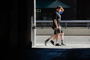 (Francisco Kjolseth  |  The Salt Lake Tribune) People wear masks in downtown Salt Lake City on Monday, August 10, 2020, as Utah's new coronavirus cases drops below 300 for the first time since early June.