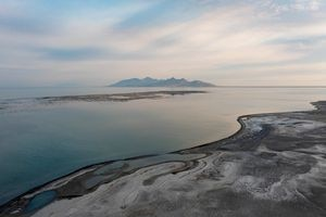 """(Francisco Kjolseth   The Salt Lake Tribune) An unusual sight emerges from the shallow waters of the Great Salt Lake as a """"reef"""" pops into view between Saltair and Antelope Island on the south end of the lake on Saturday, July 10, 2021, as extreme drought conditions impact the lake."""