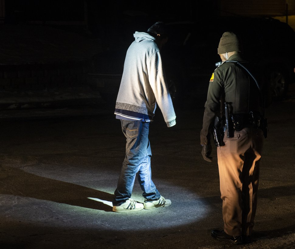 (Rick Egan   The Salt Lake Tribune) Utah Highway Patrol Trooper Daud Eftin, gives a field sobriety test, during the Highway Patrol DUI Blitz on New Year's Eve. The subject was released after passing the test. Monday, Dec. 31, 2018.