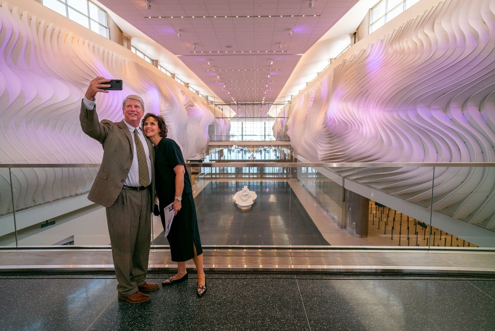 (Trent Nelson | The Salt Lake Tribune) Larry and Tammy Pinnock take a selfie with The Canyon, an art installation at the new Salt Lake City International Airport on Thursday, Aug. 27, 2020.