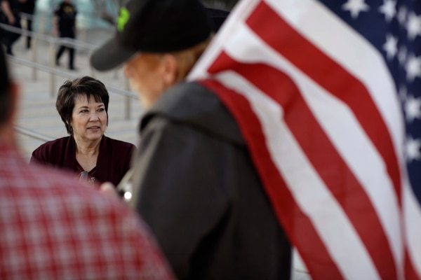 (John Locher | Associated Press file photo) Carol Bundy, left, wife of Nevada rancher Cliven Bundy, speaks with supporters outside of the federal courthouse, Thursday, Feb. 9, 2017, in Las Vegas. A jury begins to decide Thursday in Las Vegas if six men who wielded weapons to block a federal round-up of cattleman Cliven Bundy's cows in 2014 were citizens exercising constitutional free speech and weapon rights or armed insurrectionists who conspired against the government.