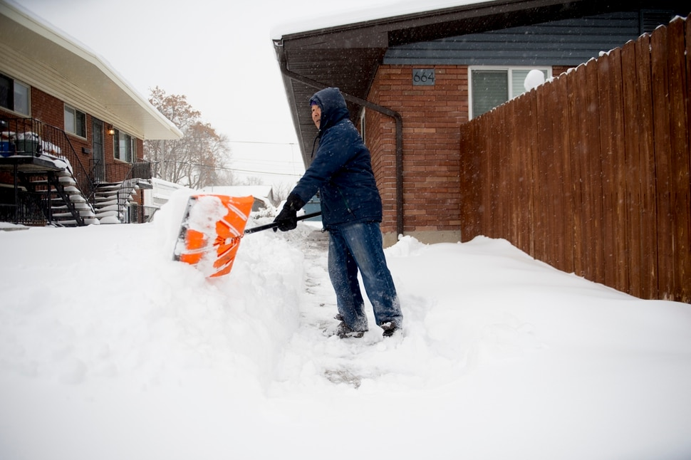 (Jeremy Harmon | The Salt Lake Tribune) Sampset Sompsou shovels the walks outside his apartment building in Salt Lake City following a heavy storm on Wednesday, Feb. 6, 2019.