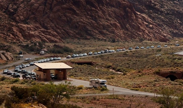 (Leah Hogsten | Tribune file photo) On Saturday, Oct. 12, 2013, there was a minimum 15-minute wait time for vehicles waiting for entrance to Arches National Park.