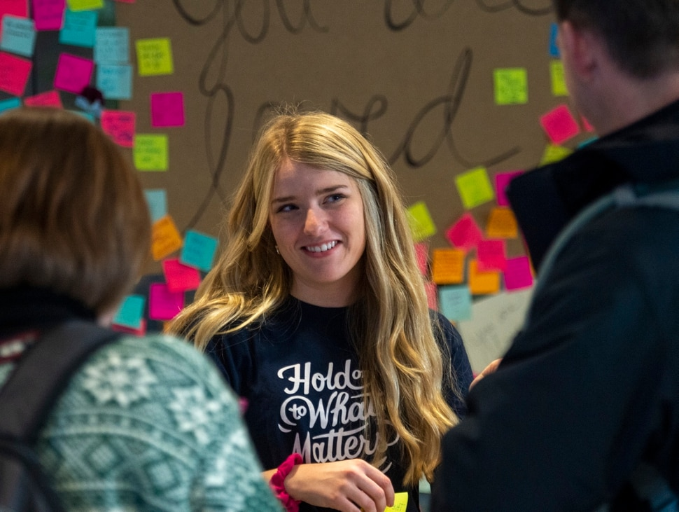 (Rick Egan | The Salt Lake Tribune) Sabrina Christensen from Allen, Texas, handed out chocolate and flowers in the Tanner Building Tuesday, as Brigham Young University students gathered to offer support to others after a student attempted suicide on Monday.