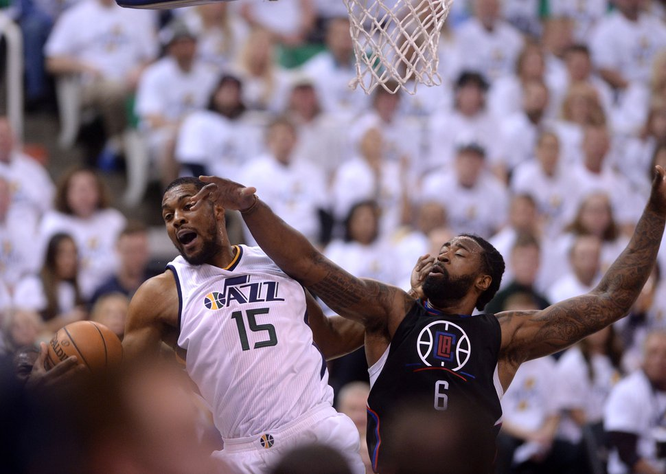 Steve Griffin | The Salt Lake Tribune Utah Jazz forward Derrick Favors (15) grabs a rebound away from LA Clippers center DeAndre Jordan (6)v during the Jazz versus Clippers NBA playoff game at Viviint Smart Home arena in Salt Lake City Sunday April 23, 2017.