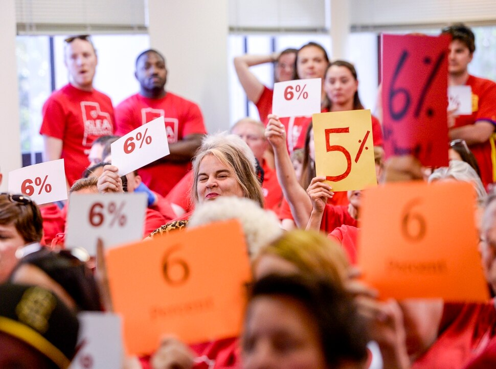 (Leah Hogsten | The Salt Lake Tribune) Teachers walk out of the public comment period at the Salt Lake City School District meeting regarding salary negotiations, June 4, 2019. More teachers are leaving Utah classrooms and one of the biggest reasons they cite is low pay. The state now has a shortage of 1,600 educators with the imbalance expected to get worse.