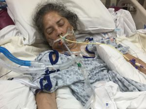 (Jeff Lewis) Pictured is Tina Lewis when she was sedated and on a ventilator in the hospital.