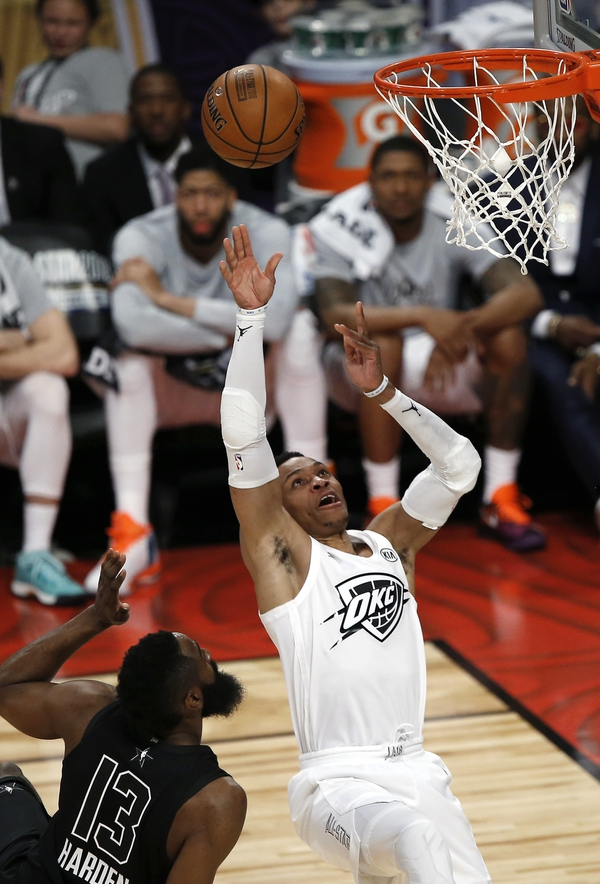 Team LeBron's Russell Westbrook, right, of the Oklahoma City Thunder, shoots as Team Stephen's James Harden, of the Houston Rockets, defends during the second half of an NBA All-Star basketball game, Sunday, Feb. 18, 2018, in Los Angeles. Team LeBron won, 148-145. (AP Photo/Alex Gallardo)