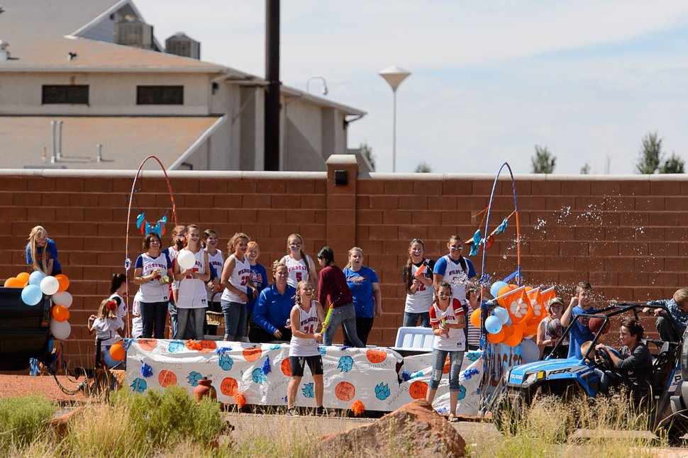 Trent Nelson | The Salt Lake Tribune Students riding a float representing Snow Canyon High School launch a water fight during the Colorado City and Hildale Fourth of July Parade in Hildale, UT, and Colorado City, AZ, Saturday July 2, 2016. At rear behind a large wall is the Leroy S. Johnson meetinghouse, used by the Warren Jeffs led FLDS Church.