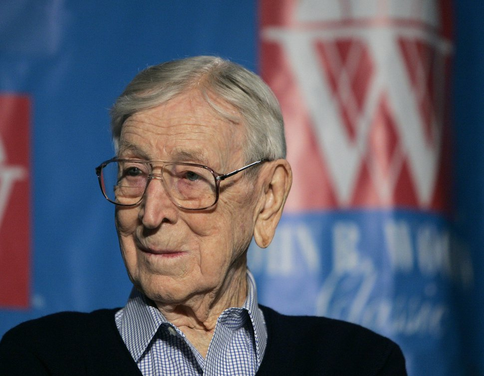 FILE - In this Dec. 9, 2005, file photo, former UCLA basketball coach John Wooden listens during a news conference in Anaheim, Calif., about the Wooden Classic basketball tournament. When New Orleans Saints quarterback Drew Brees heard a 1930s-era Purdue jersey worn by Wooden was being sold at auction, he saw an opportunity to help his alma mater showcase its ties to a man most known for winning 10 NCAA men's basketball titles as UCLA's coach. Brees says he paid $264,000 to win a late-hour bidding war for the jersey in mid-May and will allow Purdue to display it at Mackey Arena in West Lafayette, Ind. (AP Photo/Chris Carlson, File)