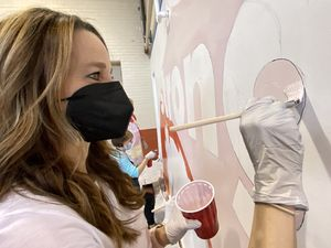(Rick Egan | The Salt Lake Tribune) Utah first lady Abby Cox works on a mural during a day of service at the Utah YWCA on Tuesday, March 2, 2021.