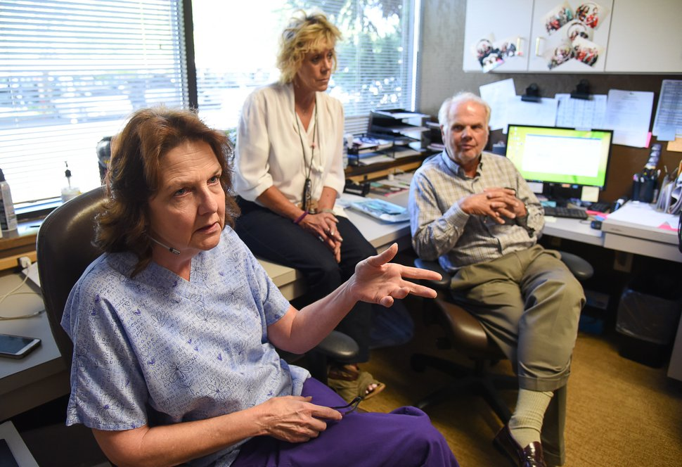 (Francisco Kjolseth | The Salt Lake Tribune) Janet Gardner, left, a billing specialist for Rocky Mountain Eye Care Associates, talks about a call she recently took from a customer concerned the ophthalmology practice's building would be seized. She is joined by manager Donna Hoppe and physician Leigh Wilkinson.