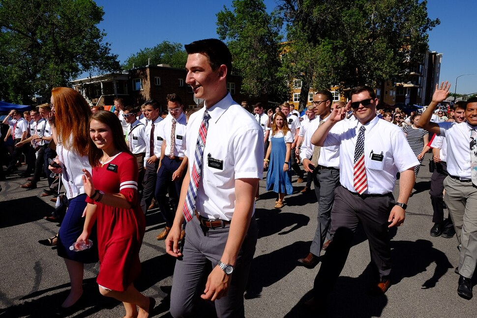 (Francisco Kjolseth | The Salt Lake Tribune) Mormon missionaries are cheered by the crowds lining the streets for AmericaÕs Freedom Festival Grand Parade on Wed. July 4, 2018, in Provo.