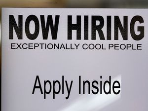 (AP File photo) A help wanted sign at Padeli's Street Greek restaurant, as seen Sept. 10, 2020, in Salt Lake City.