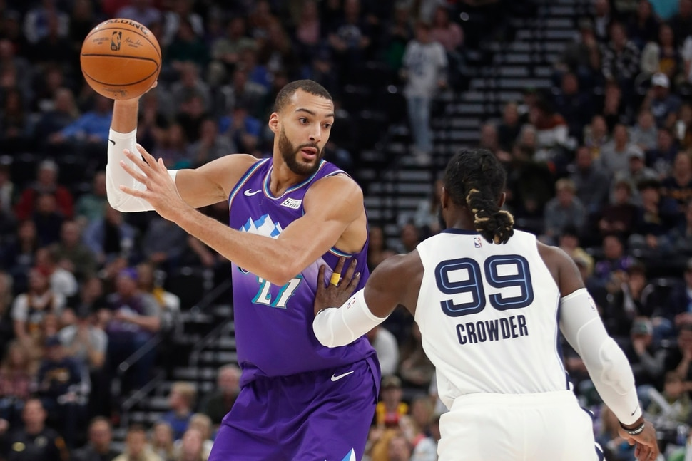 Utah Jazz center Rudy Gobert (27), is defended by Memphis Grizzlies forward Jae Crowder (99) during the first half of an NBA basketball game Saturday, Dec. 7, 2019, in Salt Lake City. (AP Photo/George Frey)
