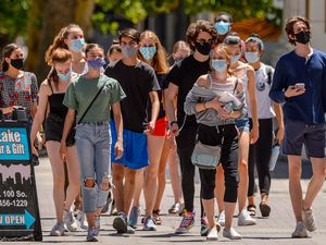 (Trent Nelson     The Salt Lake Tribune) People wearing masks on Main Street in Salt Lake City on Tuesday, June 23, 2020. Mask wearing is recommended during the current orange phase of Utah's COVID-19 effort in Salt Lake City.