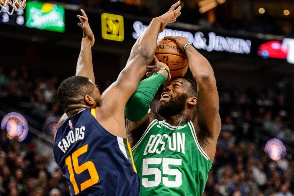 (Trent Nelson | The Salt Lake Tribune) Utah Jazz vs. Boston Celtics, NBA basketball in Salt Lake City, Wednesday March 28, 2018. Utah Jazz forward Derrick Favors (15) defending Boston Celtics center Greg Monroe (55).